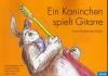 Ein Kaninchen spielt Gitarre